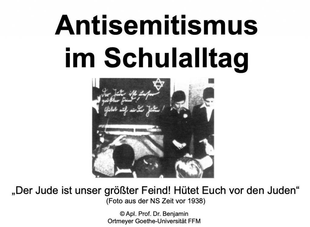 """Folie zur Vorlesung """"Antisemitismus im Schulalltag"""" von Prof. Benjamin Ortmeyer mit Zitat """"Der Jude ist unser größter Feind! Hütet Euch vor den Juden"""" Foto aus der NS-Zeit vor 1938"""